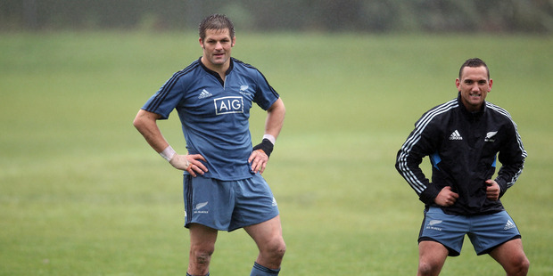 Loading Richie McCaw and Aaron Cruden keep an eye on events during a New Zealand All Blacks training session at the University Oval, Dunedin on June 10, 2014 in Dunedin. Photo / Getty Images.