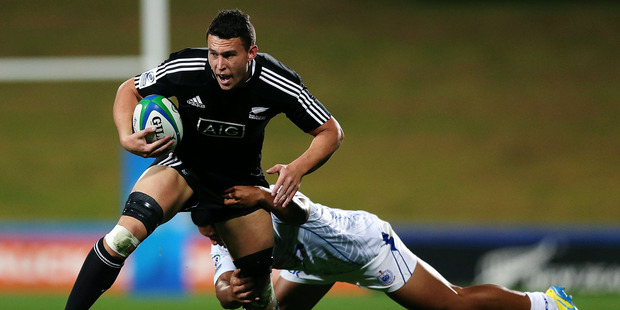 Kyle Harris of New Zealand is tackled during the 2014 Junior World Championships match against Samoa. Photo / Getty Images
