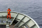 A lookout is stationed on bow of HMAS Success during the search of the missing MH370. Photo / AP