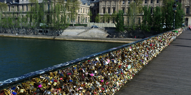 April 9, 2014 file photo shows love locks fixed on the Pont des Arts in Paris. Photo / AP