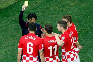 Referee Yuishi Nichimura from Japan gives penalty kick against Croatia. Photo / AP