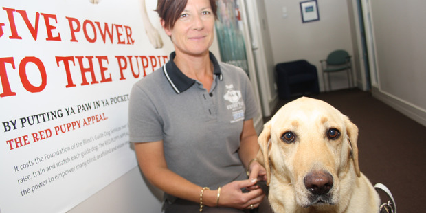 Royal New Zealand Foundation of the Blind dog trainer, Kim Norton, with Skye, a guide dog. Photo / Dani McDonald