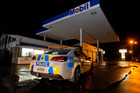 SCENE: Police at the scene of tonight's robbery at Bay View. TLR49256mobil.JPG