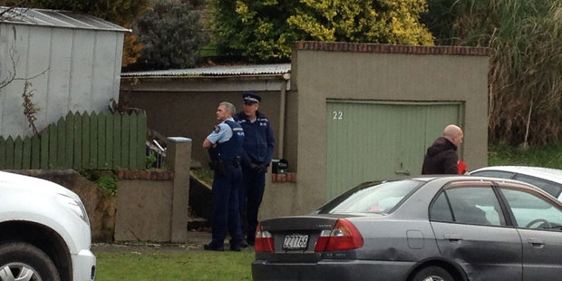 Police outside the house where the body was found. Photo / Craig Baxter / Otago Daily Times