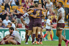 Dale Copley of the Broncos celebrates with Lachlan Maranta and Ben Hunt after scoring a try. Photo / Getty Images