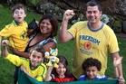 Brazil football fans, from left, back, Zelita Mahoney holds her son Dominic, 8, alongside Washington Almeida; front, Eduardo Mahoney, 8, Rebecca Almeida, 7, and Gabriel Rodrigues, 6. Photo / John Stone