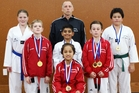 Aotearoa Taekwondo's team, back row: Faith Waterman (left), Jim Thomas (assistant coach), Tristan Hanlen. Middle row: Orion Thomas, Lakshya Dhillion, Blake Ward. Front: Mahinarangi Wirihana.
