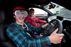 Hamilton mechanics student David Randall-Leon about to take off wearing goggles that simulate what it's like to drive while intoxicated - all under the watchful eye of instructor Stu Owers. Photo / Richard Robinson