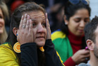 A Brazilian fan watching the game. Photo / Greg Bowker