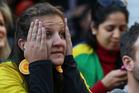A Brazilian fan watching the game. Photo / Greg Bowker