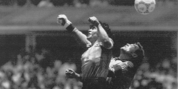 Argentina's Diego Maradona, left, famous 'Hand of Goal' goal against England goalkeeper Peter Shilton in the 1986 World Cup. Photo / AP