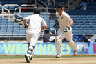 New Zealand batsmen Jimmy Neesham, right, and BJ Watling, run between the wickets. Photo / AP