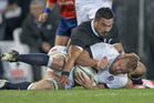 Jerome Kaino tackles England captain Chris Robshaw. Photo / Brett Phibbs