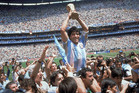 Diego Maradona celebrates with the World Cup after the 1986 final in the Atzeca Stadium, in Mexico City. Photo / AP