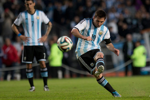 Lionel Messi kicks a soccer ball during a football match for Argentina. Photo / AP