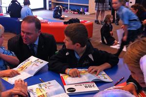 John Key chats with kids at Pegasus Bay School. Photo / APNZ