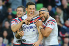 Sonny Bill Williams of the Roosters is congratulated by his teammates after scoring against the Storm. Photo / Getty Images