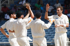 New Zealand's bowler Tim Southee, right, is congratulated by teammates after taking the wicket of West Indies batsman Kieran Powell. Photo / AP