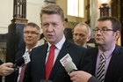 David Cunliffe, flanked by David Parker, left, and Grant Robertson at yesterday's press briefing. Photo / Mark Mitchell
