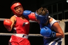 Wellsford's Magan Maka, boxing out of the blue corner, was a clear winner over Roeanna Cox in the Boxing Explosion 3 event at ASB Stadium on Saturday night. Photo/John Stone