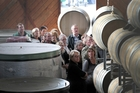 Clearview Estate Winery owner/winemaker Tim Turvey (front) leads a tour through the Te Awanga winery's barrel room. Photo/Duncan Brown