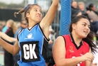 Whangarei Netball Centre's Ricco Watts-Niha, left, fights for the ball at the Auckland Representative Tournament. Photo / Jo Kirby