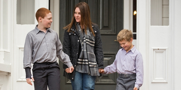 Dianna Perron with her two boys Callum, 10, and 8-year-old Finn Goodson at King's School. Photo / Greg Bowker