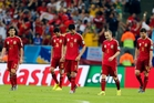 Spanish players walk away in dejection  after Chile's Charles Aranguiz scored his side's second goal. Photo / Manu Fernandez