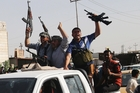 Iraq Shia fighters answer a call to arms in Basra, 550km southeast of the capital, Baghdad. Photo / AP