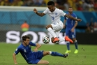 Raheem Sterling, 19, is challenged by Italy's Matteo Darmian at the World Cup. Picture / AP