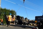 A truck rolled closing one lane of State Highway 2 for nearly five hours on Saturday. Photo/Jenta Brown