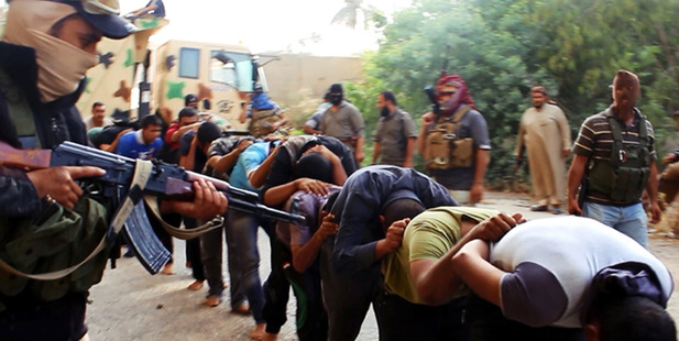 This image appears to show militants from the al-Qaeda-inspired Islamic State of Iraq and the Levant (ISIL) leading away captured Iraqi soldiers after taking over a base in Tikrit, Iraq. Photo / AP