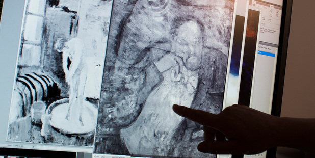 Patricia Favero, associate conservator at The Phillips Collection, points to an image of a man found underneath one of Picasso's first masterpieces. Photo / AP