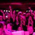 T-Mobile employees are bathed in pink light as they cheer during a speech by CEO John Legere at T-Mobile's 'Un-carrier' event in Seattle. Photo / AP