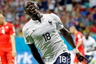 France's Moussa Sissoko celebrates after scoring his side's final goal in their 5-2 win against Switzerland. Photo / AP