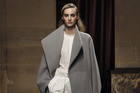For the commute? An oversized coat, like this from Hermes for Fall 2014, instantly updates a simple look. Picture / AP Images