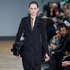 A tunic over pants is a unique take on modern workwear, like this look from Celine for Fall 2014 - best suited to less conservative offices. Picture / AP Images