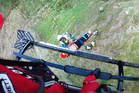 Paramedic Ryan Sutherland assists with winching a man into the Lowe Corporation Rescue Helicopter after a fall in Tangoio, north of Napier, yesterday. Photo/Supplied