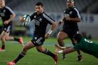New Zealand 1st-five Richie Mo'unga in action against Ireland. Photo / Brett Phibbs
