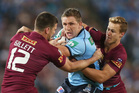 Ryan Hoffman of the Blues is tackled by Daly Cherry-Evans and Matt Gillett of the Maroons. Photo / Mark Metcalfe