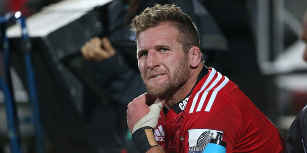 Kieran Read of the Crusaders sits on the sideline after leaving the field during the match between the Crusaders and the Hurricanes for failing a sideline concussion test. Photo / Getty Images