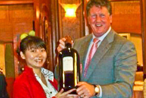 Liu's partner and the bottle of wine.