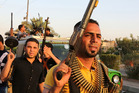 Iraqi Shiite tribal fighters ready to defend Baghdad against the jihadi army of Sunni rebels who have swept through four Iraqi cities to the north. Photo / AP