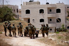 Israeli soldiers conduct a military operation to search for three missing teenagers outside the West Bank city of Hebron. Photo / AP