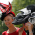 Race goers hang onto their hats in a gusty wind as they arrive on the first day of the Royal Ascot horse racing meeting at Ascot, England. Photo / AP