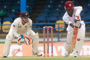West Indies batsman Kraigg Brathwaite, right, defends his wicket as New Zealand's wicket keeper BJ Watling, left, watches during the second day of their second cricket Test match. Photo / AP