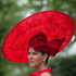 Milnda Strudwick wears a large red ornate hat on the second day of the Royal Ascot horse racing meeting at Ascot, England. Photo / AP