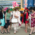 Paula Iachetti, centre, poses with a group of women for photographers on the third day of the Royal Ascot horse racing meeting, which is traditionally known as Ladies Day. Photo / AP
