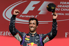 Red Bull driver Daniel Ricciardo, from Australia, celebrates after winning the 2014 Canadian Grand Prix. Photo / AP
