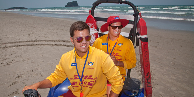 Lifeguards Jackson Edwards (left) and Steven Gregory patroling at Tay St Beach.